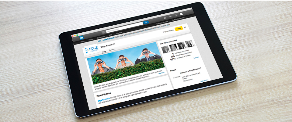 Edge Research company LinkedIn page shown on an iPad. The social media profile page uses brand elements consistent with the company's visual branding system.